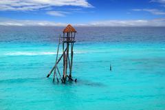 Caribbean zip line tyrolean turquoise sea - stock photo