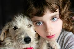 dog puppy pet and girl hug portrait closeup blue eyes - stock photo