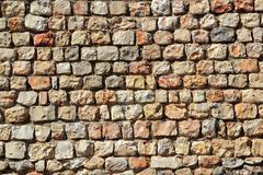 Brown masonry stone wall Spain traditiona Stock Photos