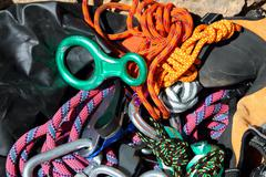 Climbing equipment shackles harnesses ropes Stock Photos