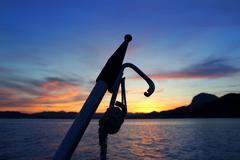 Cape San Antonio Javea Xabia sunset from sea - stock photo