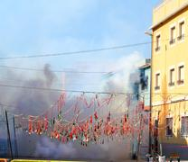 fireworks firecrackers exploding in smoke street - stock photo