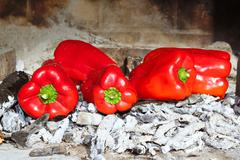 grilled red peppers ember fire - stock photo