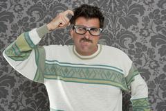 nerd pensive silly man retro wallpaper glasses tacky - stock photo