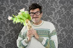 Stock Photo of anger funny man violent expression flowers vase