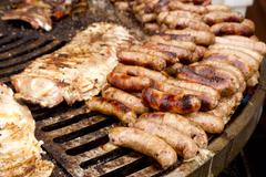 Stock Photo of grilled sausage and ribs unhealthy food