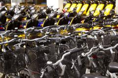 bicycles and scooter bikes rows in a renting shop - stock photo