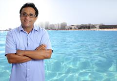 Indian latin tourist man in tropical caribbean beach Kuvituskuvat