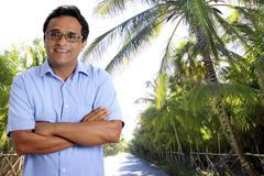 Indian latin tourist man in tropical palm tree caribbean Kuvituskuvat