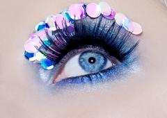 Blue eye macro closeup makeup sequins colorful - stock photo