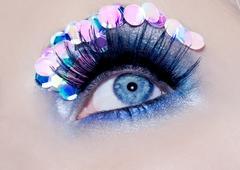 Blue eye macro closeup makeup sequins colorful Stock Photos