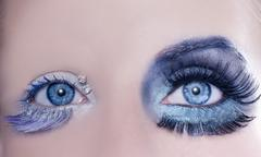 asymmetrical blue eyes makeup macro closeup silver - stock photo