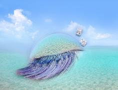 Caribbean sea eye makeup metaphor turquoise beach Stock Photos