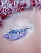 christmas concept eye makeup winter red silver macro - stock photo