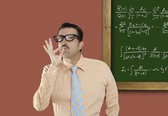 Genius nerd glasses silly man board math formula - stock photo