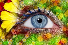 blue woman eye makeup spring flowers metaphor - stock photo