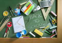 Back to school written blackboard green board - stock photo
