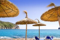 Andratx Port de Mar beach with sunroof umbrellas - stock photo