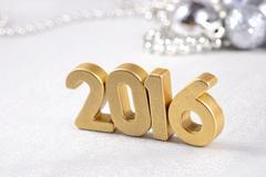 Stock Photo of 2016 year golden figures and silvery Christmas decorations