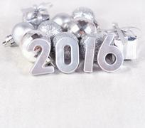 2016 year silver figures and silvery ?hristmas decorations - stock photo