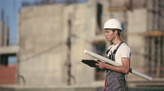 Engineer builder using tablet and walkie talkie, giving instructions Stock Footage