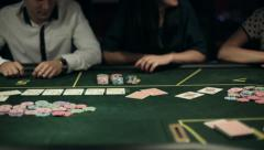 Casino, poker: Group of people in poker club gambling at poker card table Arkistovideo