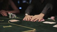 Poker players man wins and takes the money Stock Footage