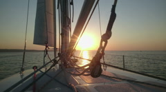 Yachting at sunset, active lifestyle, luxury hobby, view from sailboat, tourism Stock Footage