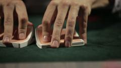 Dealer shuffles the poker cards Stock Footage