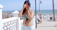 Pretty young woman in trendy summer fashion - stock footage