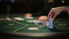 Poker player shows his good pair hand for win two aces and doing bet Stock Footage