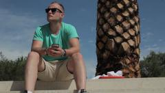 Man talking on the phone with family. He's on vacations. Stock Footage
