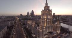 Aerial of Ukraina hotel and Moscow city at sunset, Radisson Royal Hotel, Russia Stock Footage