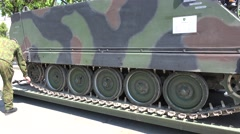 Military vehicle light tank on transportation platform and soldiers. 4K Stock Footage