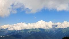 Clouds over the mountain ridge. Krasnaya Polyana, Sochi, Russia. 1280x720 Stock Footage