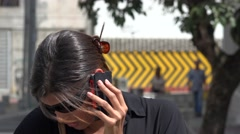 Woman Using Cell Phone - stock footage