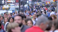 Large crowd people walking crowded street pedestrians commute New York City NYC - stock footage