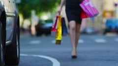 Girl on street of big city with shopping bags, defocused.  Stock Footage