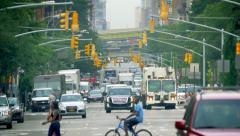 Urban Manhattan busy street traffic New York City NYC cars trucks pedestrians - stock footage