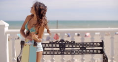 Young woman leaning on her skateboard Stock Footage