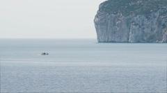 Boat near Capo Caccia Cliff Sardinia Italy - 29,97FPS NTSC Stock Footage