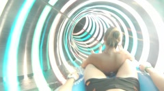 People ride at a water slide with bright circles Stock Footage