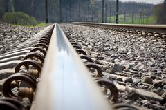 Railroad tracks at a train station - stock photo