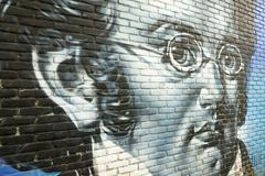 Graffiti on a wall with a portrait of Franz Schubert. Stock Photos