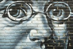 Graffiti on a wall with a portrait of Franz Schubert. - stock photo