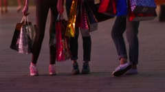 Three friends, young girls on street of big city with bunch of shopping bags. Stock Footage
