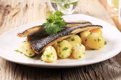Stock Photo of Pan fried trout with potatoes