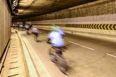 Motion blur of cyclist in underground road. Stock Photos