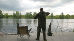 Fishermen throw gear on the river bank in the city park. Stock Footage