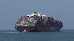 Side view + rear container ship Yang Ming Uniform, turning outbound Stock Footage